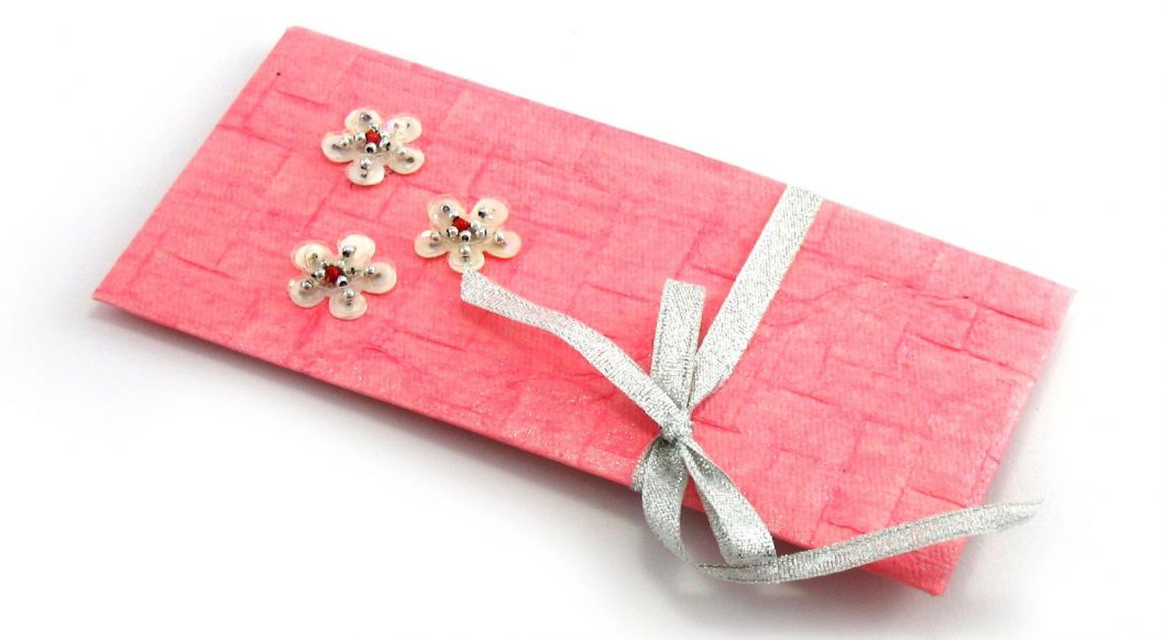 envelope pink with ribbon